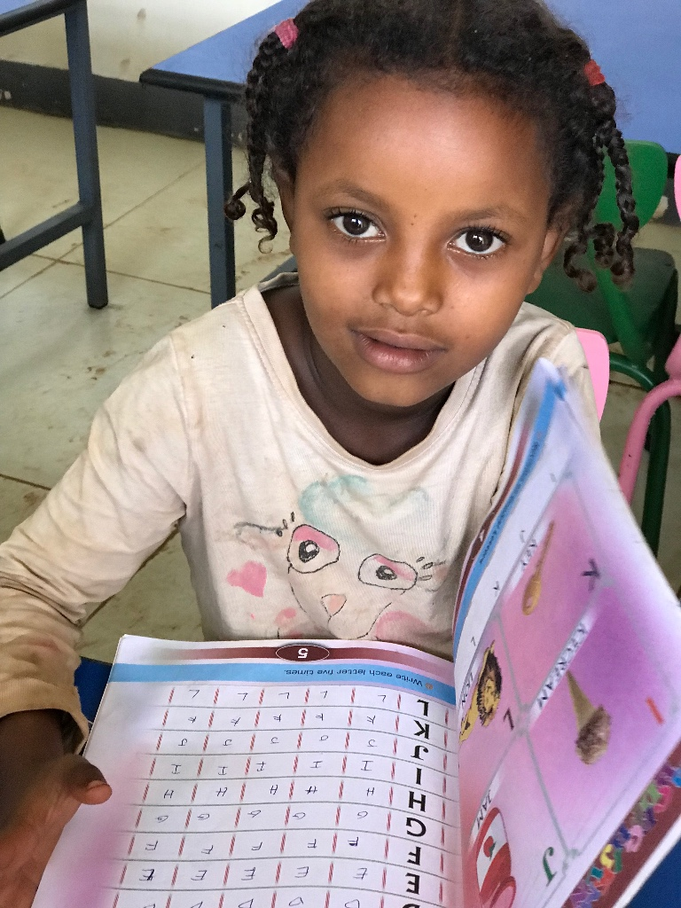 A Degale Children's Library regular smiles for the camera as she learns her ABCs!