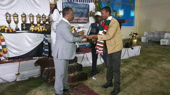 WEEMA's Project Coordinator, Amanuel Abebo, accepts the award on WEEMA's behalf