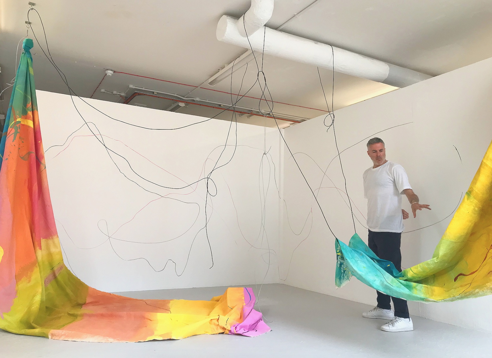 The artist Neil Tait engaging with the work. July 2019.