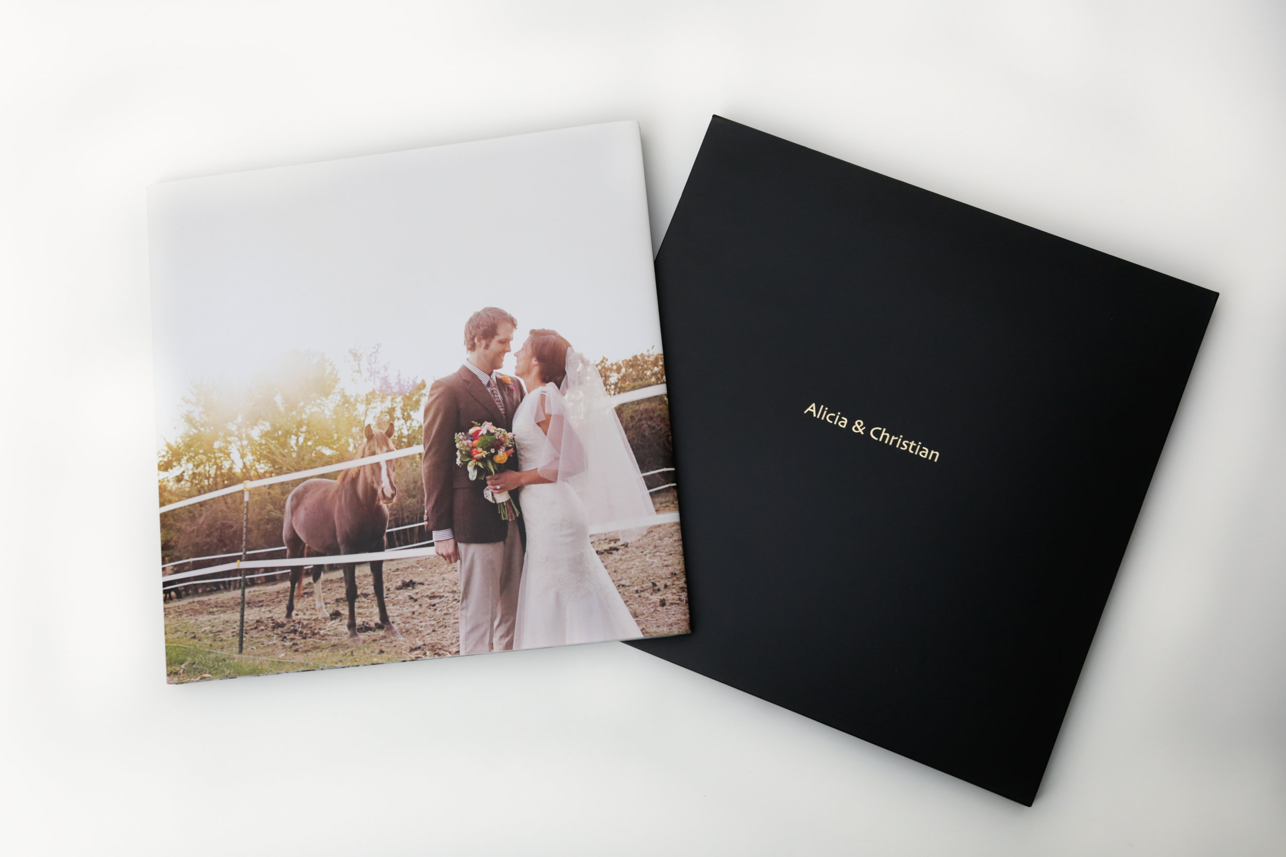 Modern Album     BOOK A FULL WEDDING DAY FOR 2017 AND RECEIVE A 10X10, 30 PAGE, MODERN ALBUM! A DESIGNABLE HARDCOVER PROTECTED BY MATCHING BOOK JACKET WITH DESIGNABLE INSIDE FLAPS. MAGAZINE-STYLE PAGES WITH GUTTERLESS LAYFLAT BOOK BINDING. OPTIONS OF BLACK OR RED SLIDE-IN CASE AND PERSONALIZED HOT STAMP.  FULL PACKAGE involves - Full-day coverage, portal cards for family and friends to view photos online, online proofing site for family and friend ordering, all images on CD or flash drive with special selection, ENGAGEMENT SESSION INCLUDED  $3,000!  WEDDING DAY NOT UNTIL 2018? THAT'S OKAY! IF YOU BOOK DURING 2017, YOU STILL QUALIFY!