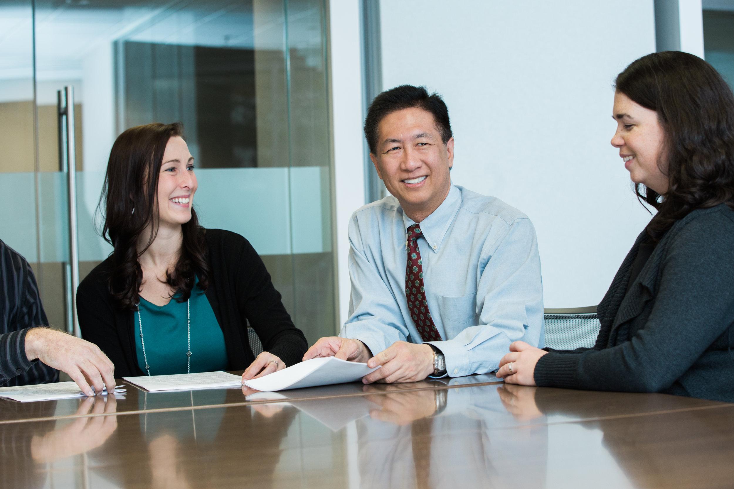 Pictured Above: Hope Cichra, Senior Paralegal; Duke W. Yee, President/Owner; Kelly Sullivan, Associate Attorney