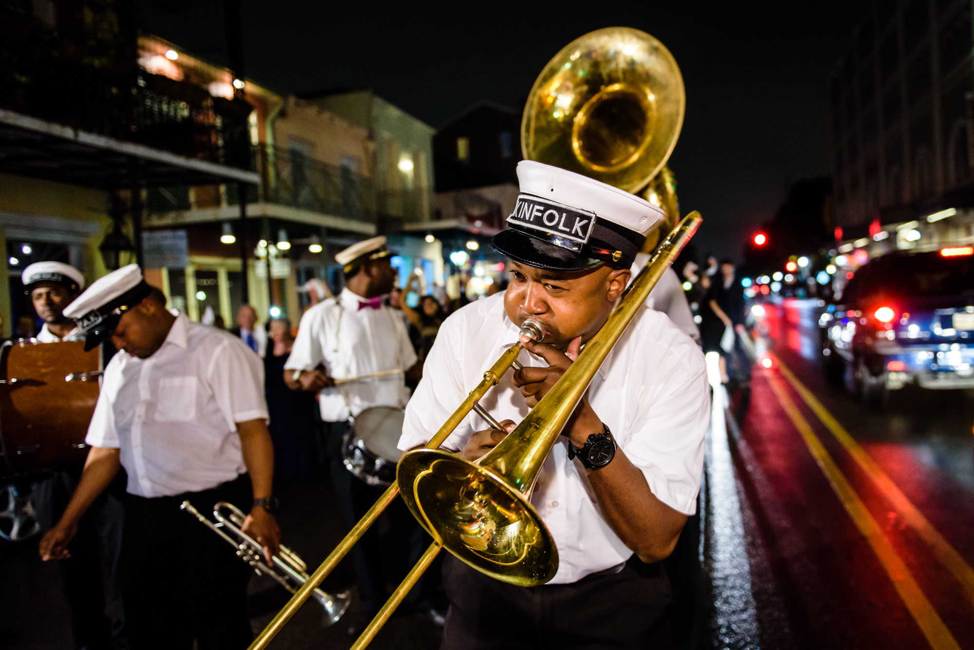 Kinfolk brass band leading a second line parade through the streets of the French Quarter