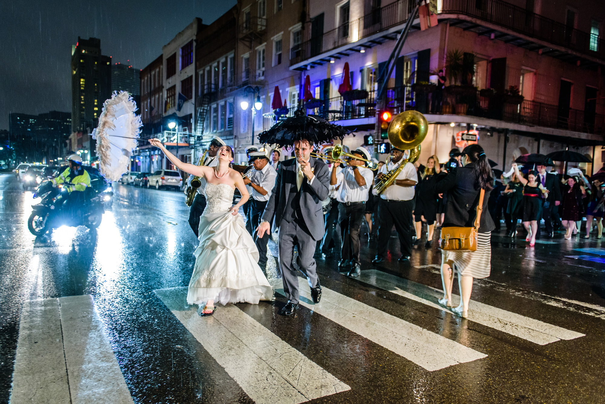 Not even rain stops a New Orleans wedding second line parade.