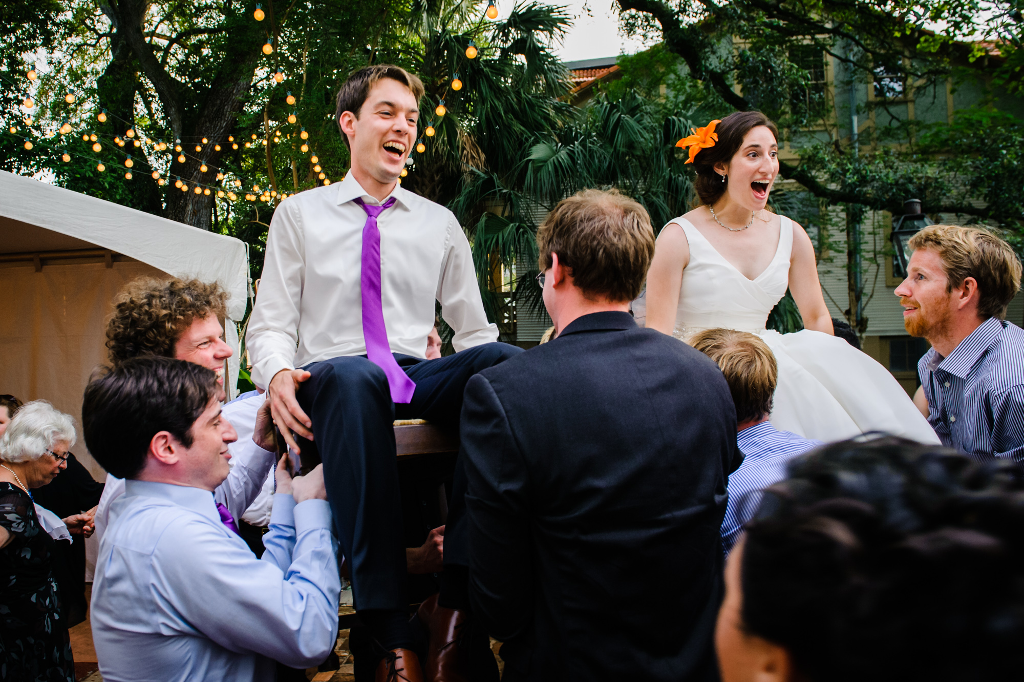 Bride and groom being lifted in chairs as part of the Jewish wedding tradition, Degas House, New Orleans