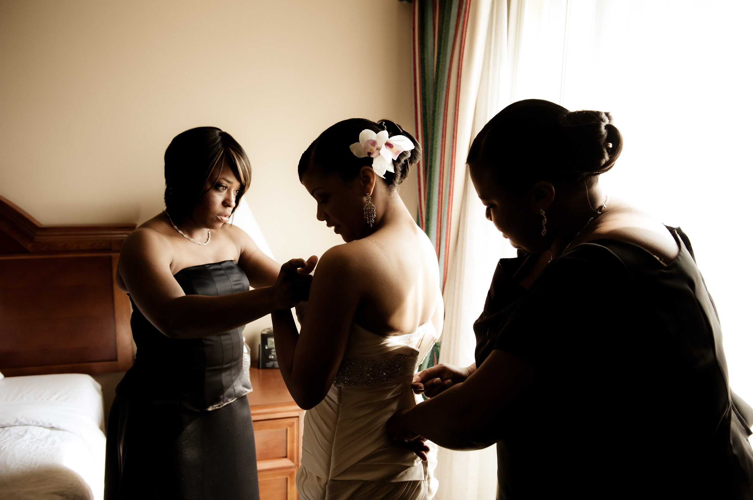 Bridesmaids help bride prepare for a wedding, New Orleans
