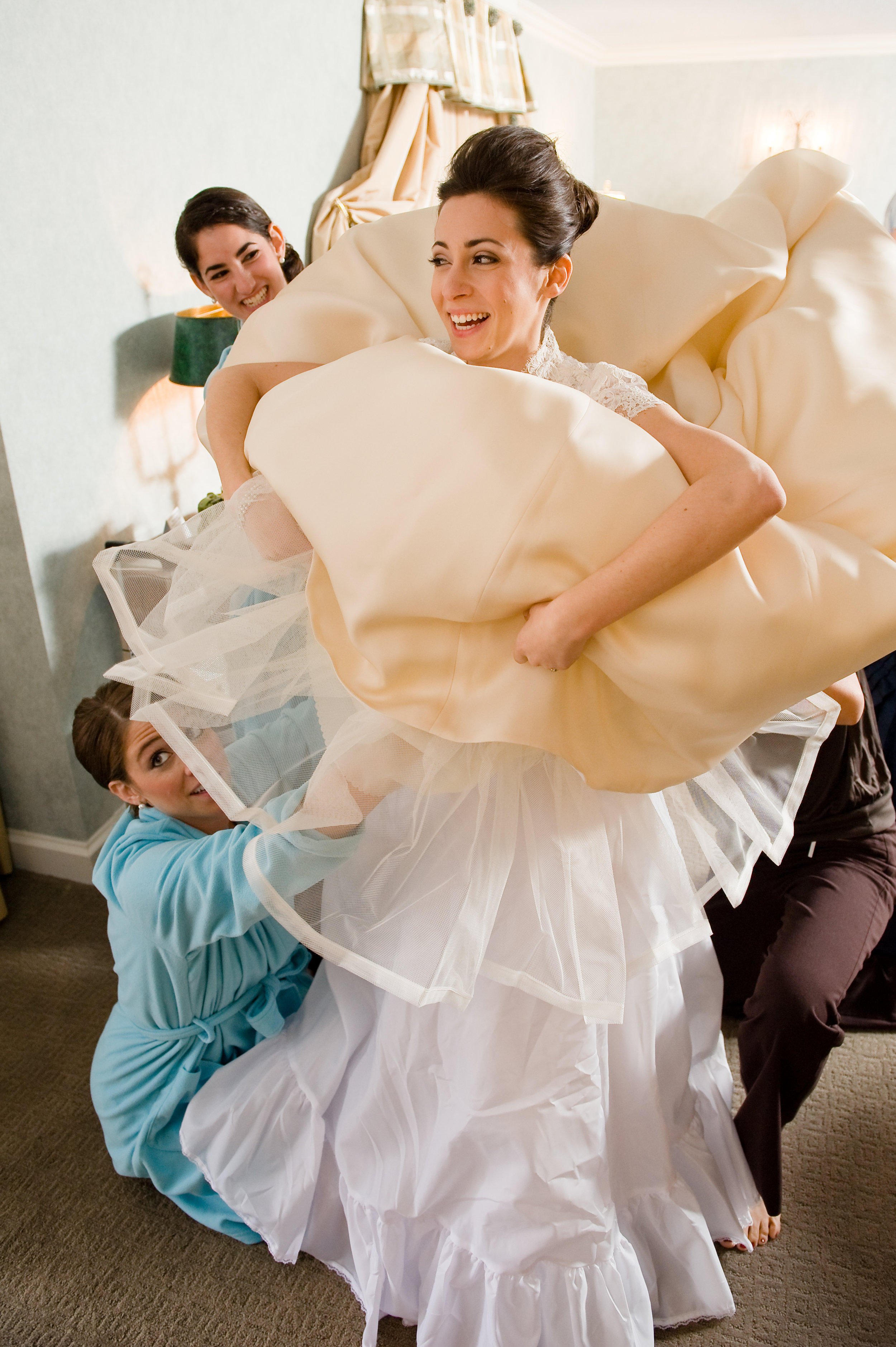 A bride gets a hand from her bridesmaids, photographed by Scott Myers