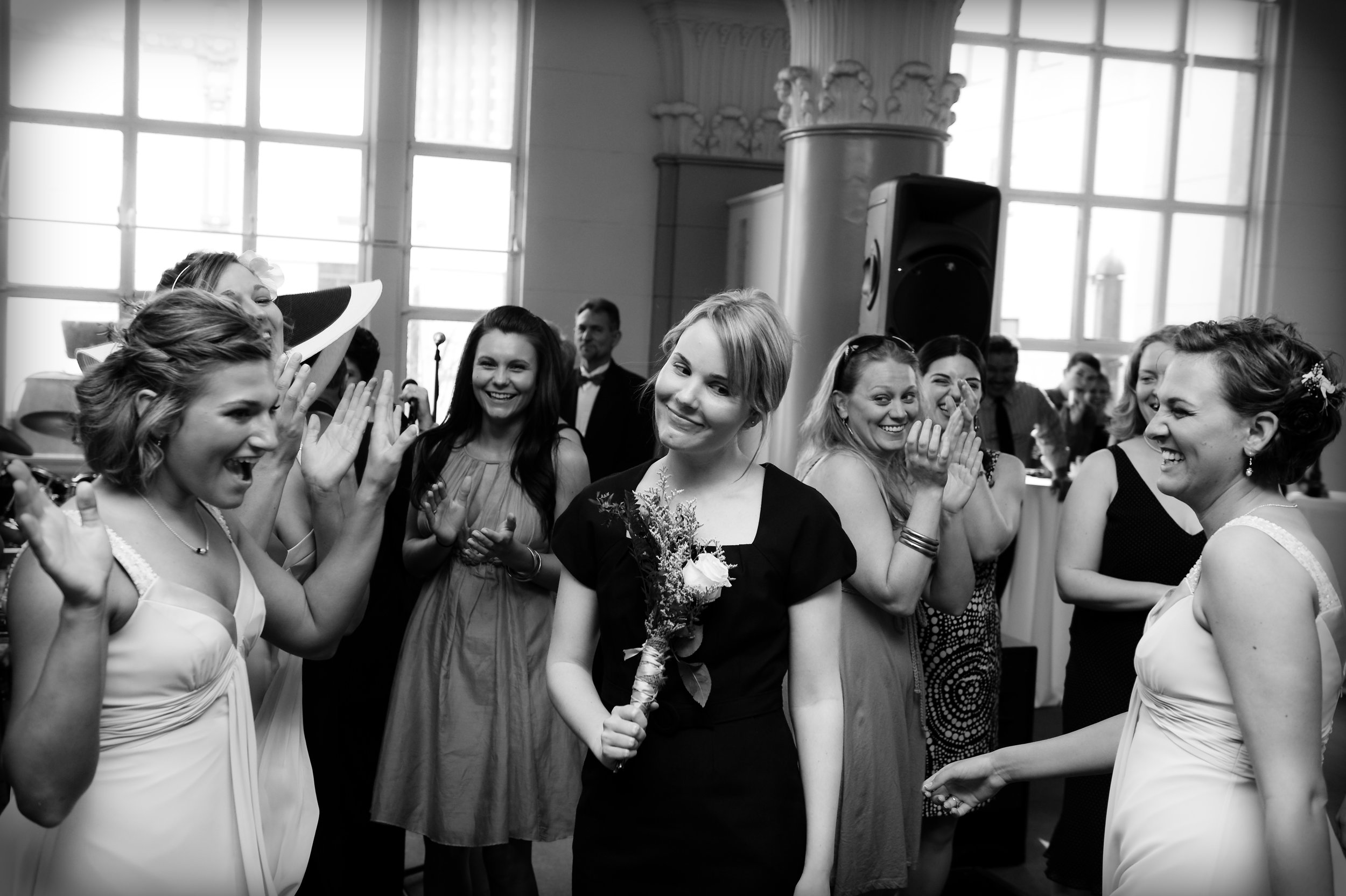 Winner of the bridal bouquet toss, photographed by Scott Myers