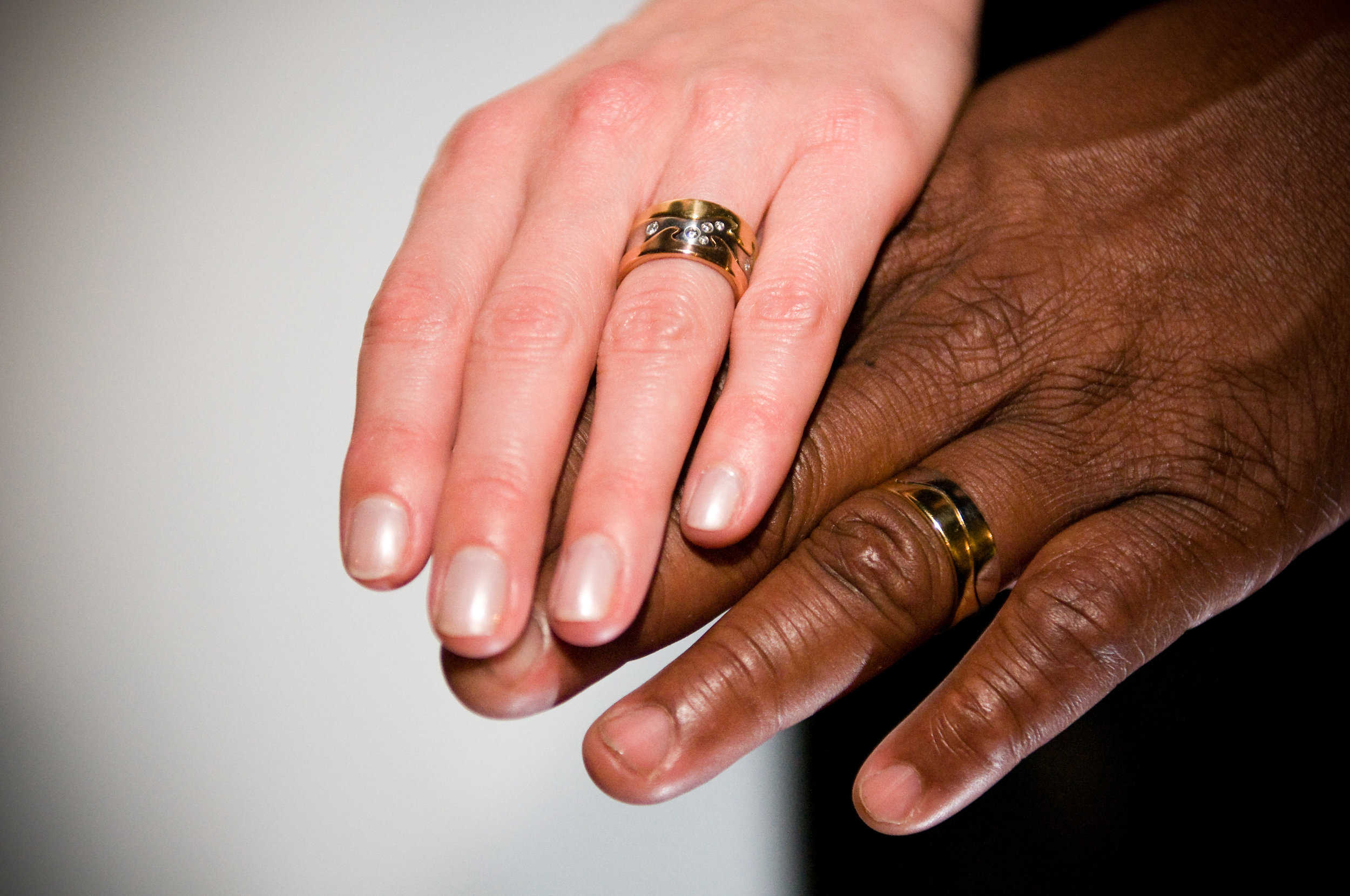 Bride and groom's hands and wedding rings, New Orleans
