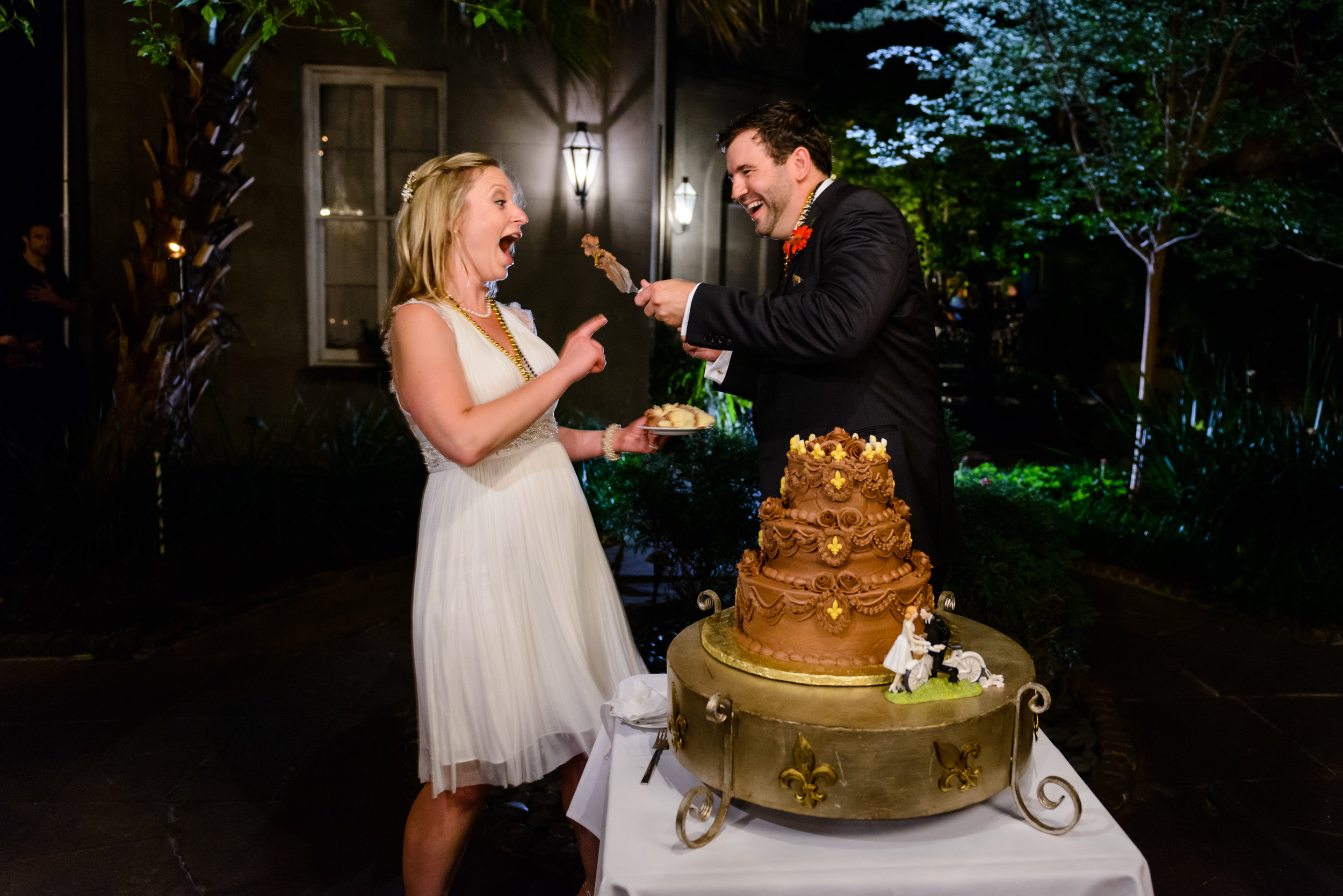 Bride and groom cutting cake at Cafe Amelie, New Orleans