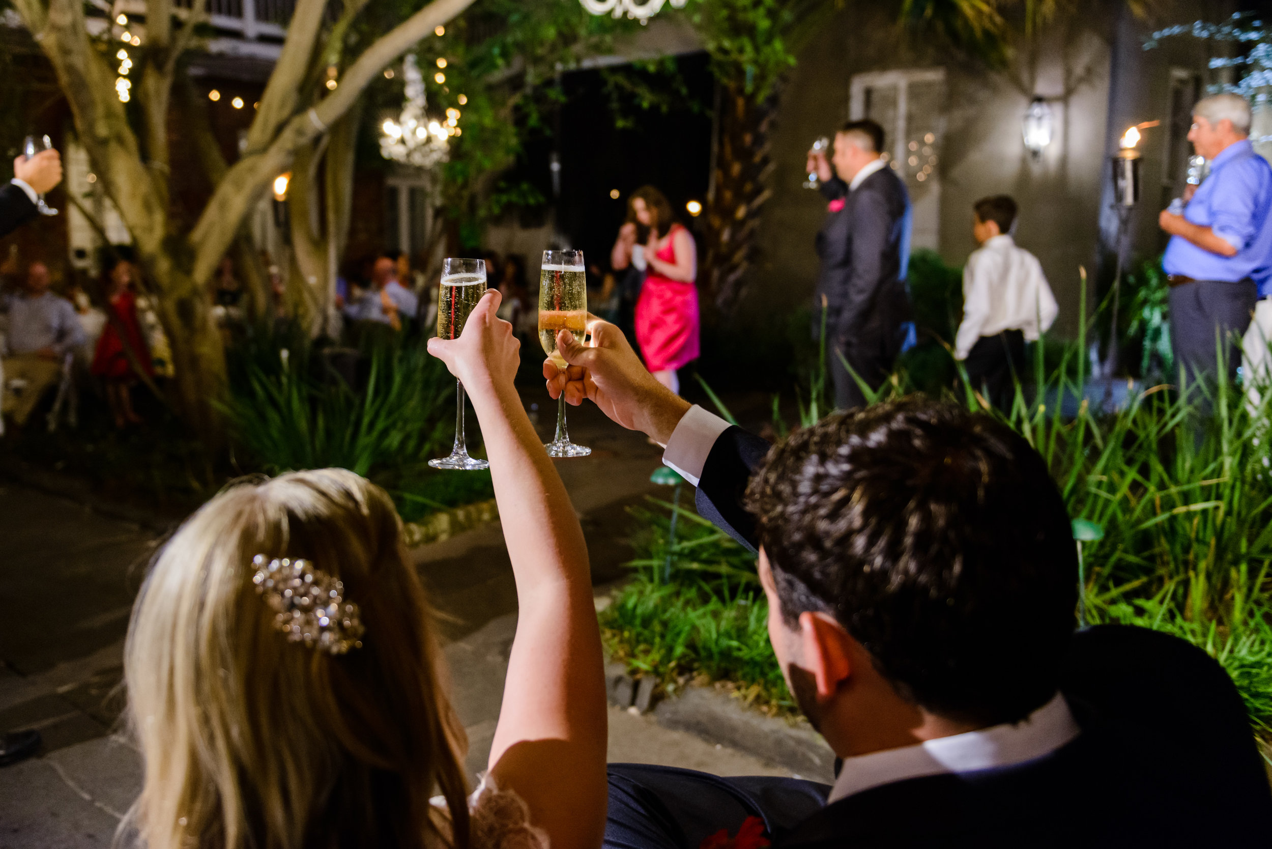 Toasting the bride and groom at Cafe Amelie, New Orleans