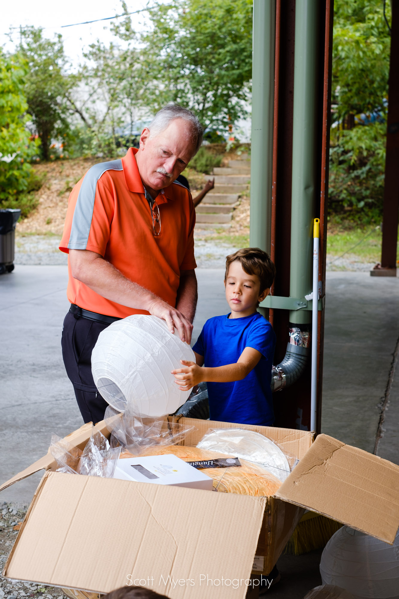 My uncle Richard, and my nephew Theodore, putting together paper lanterns