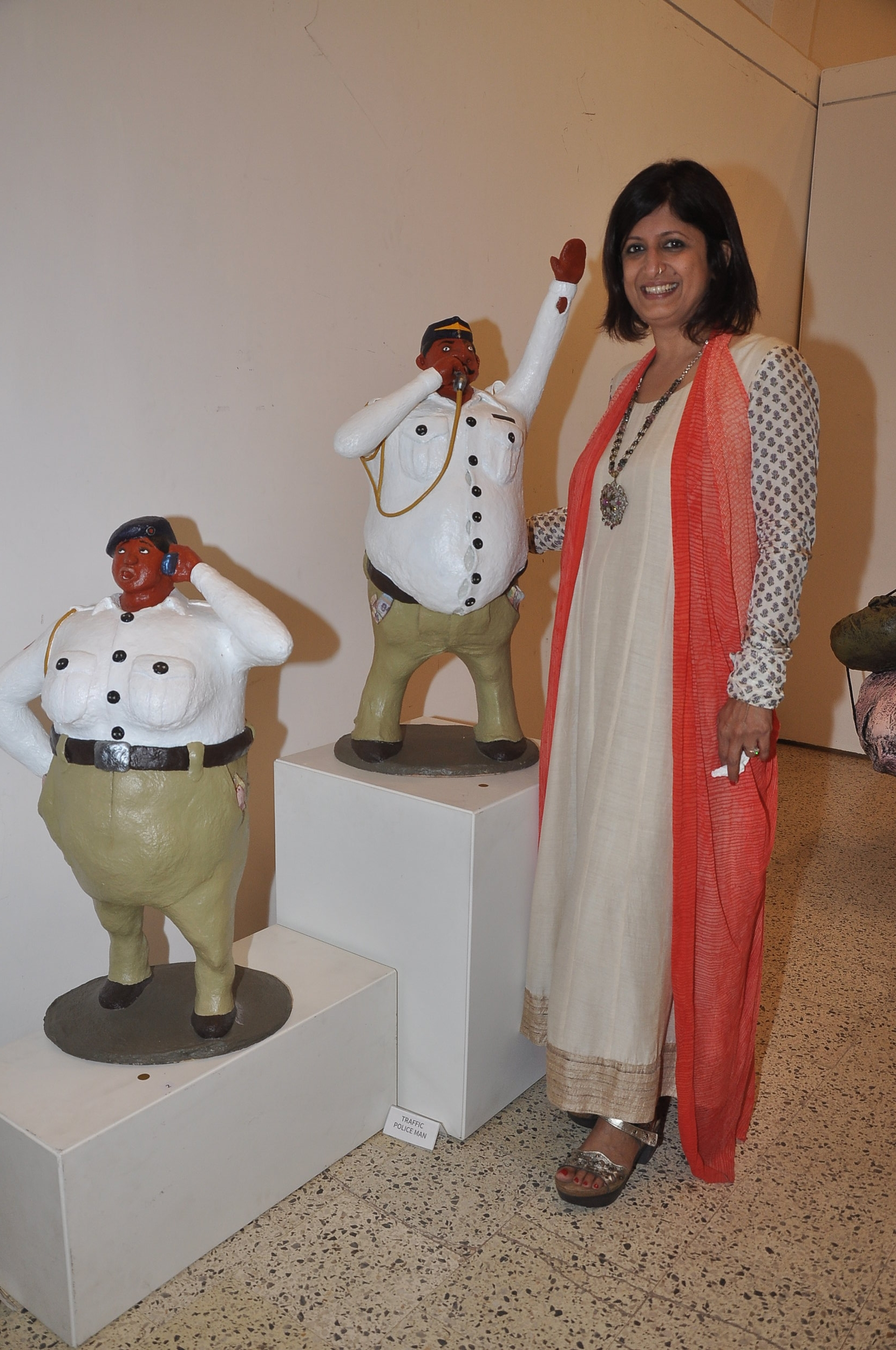 Artist Bharati Pitre with her sculptures (Traffic Police Man & Woman) at the opening of her show 'What a Wonderful World' at Jehangir Art Gallery, Mumbai.
