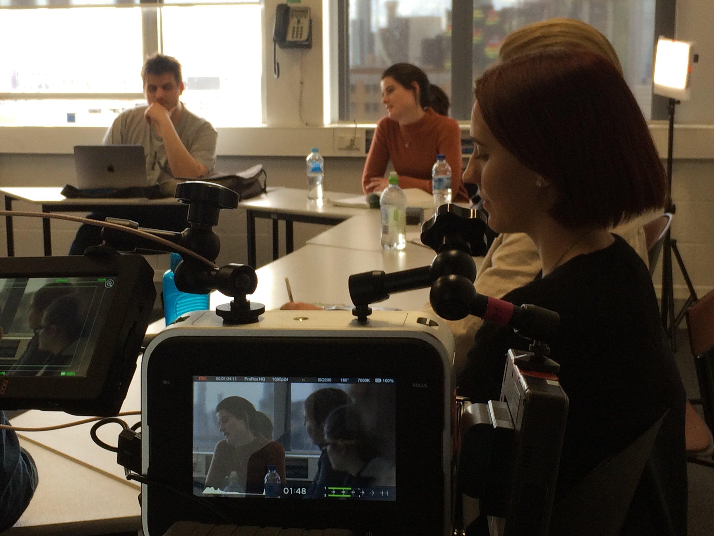 B. Behind the scenes