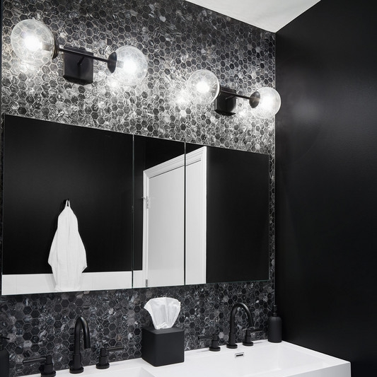 DOMINO    Time was up for these flesh-colored, tired bathrooms. Interior Designer, Devon Fromm of Devon Grace Interiors transformed her guest and master baths into edgy, black, white and marble spaces that finally fit with the rest of the condo.
