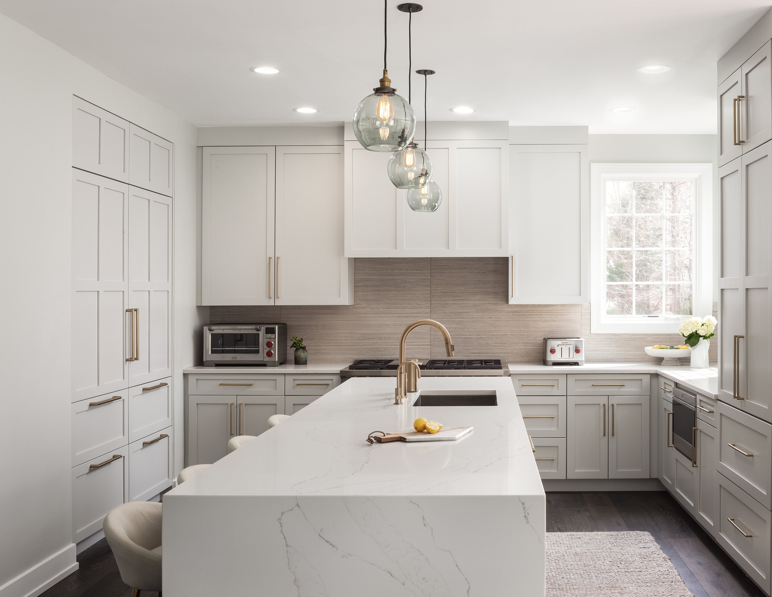 The new kitchen is bright, inviting and warm, truly representing the heart of the home.