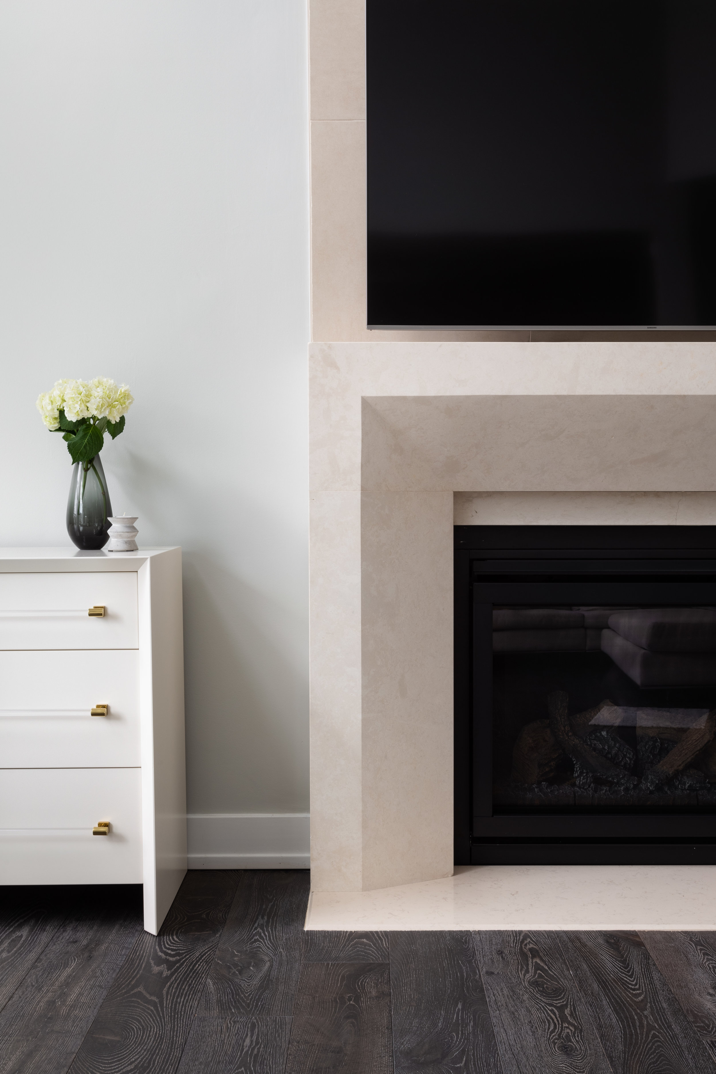 We're still furnishing this room, so we'll reveal the full family room in a later post, but here's a peak of the fireplace we designed with  Paris Ceramics.