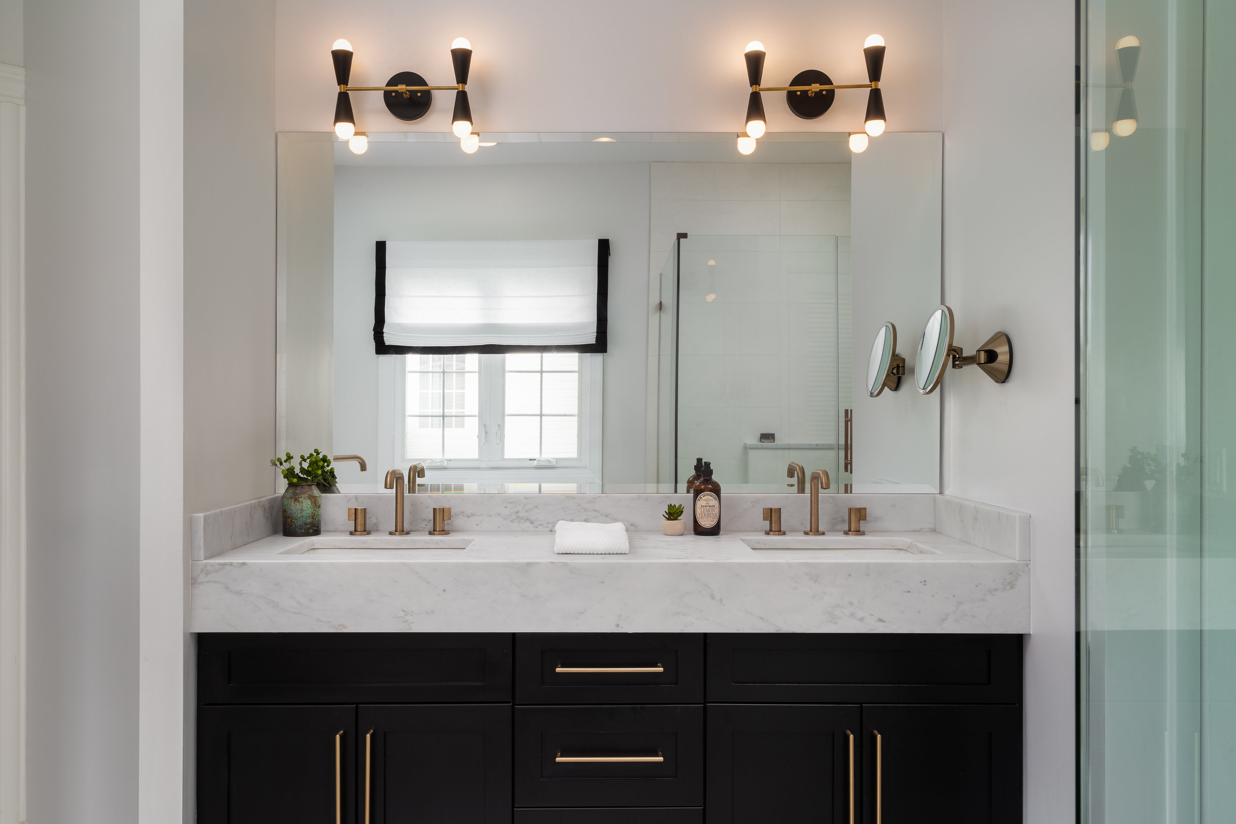 To add some drama, we created a black vanity with a six-inch mitered countertop edge.