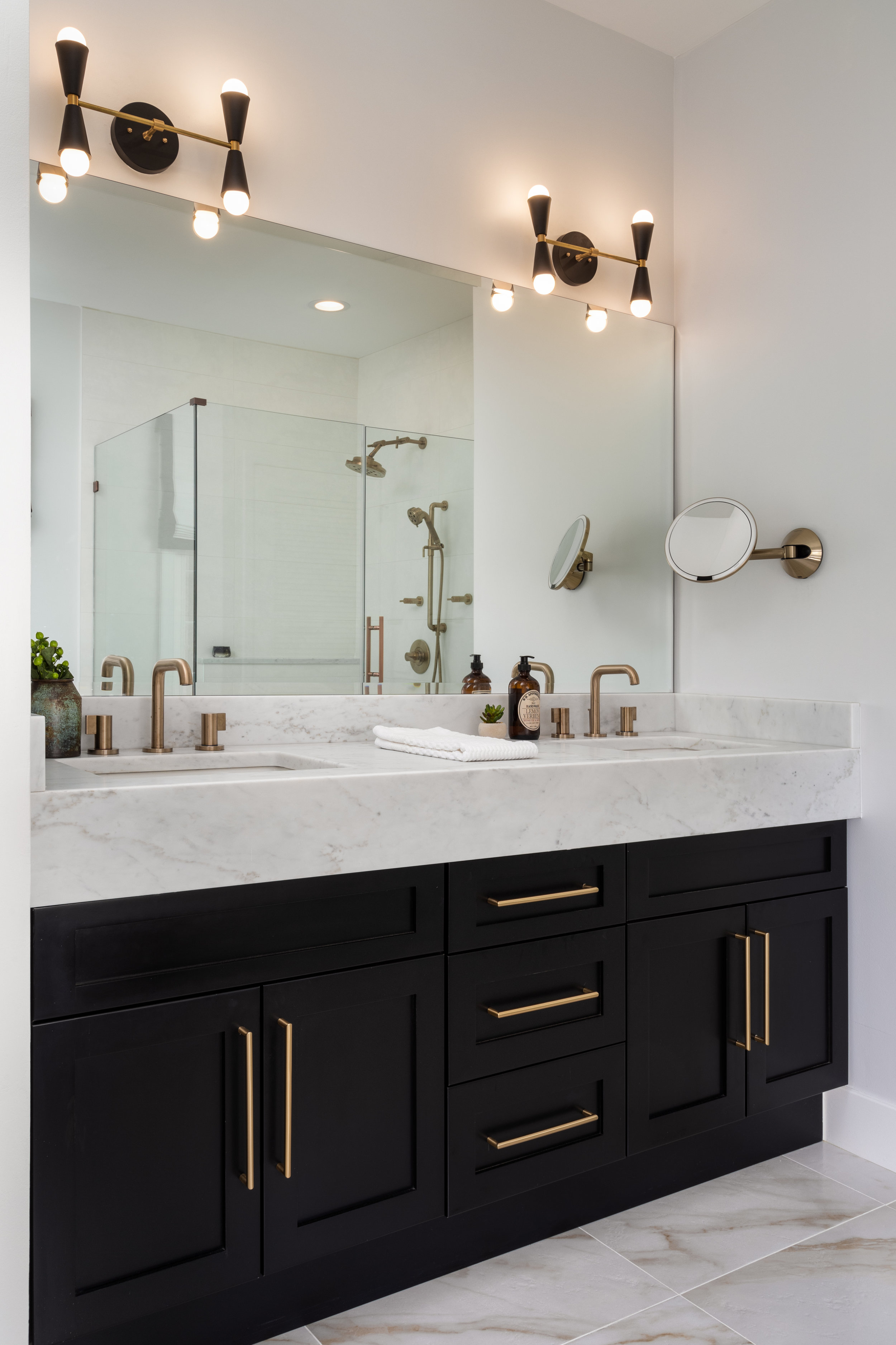 Brass hardware adds a warm and delicate contrast to the black cabinets.