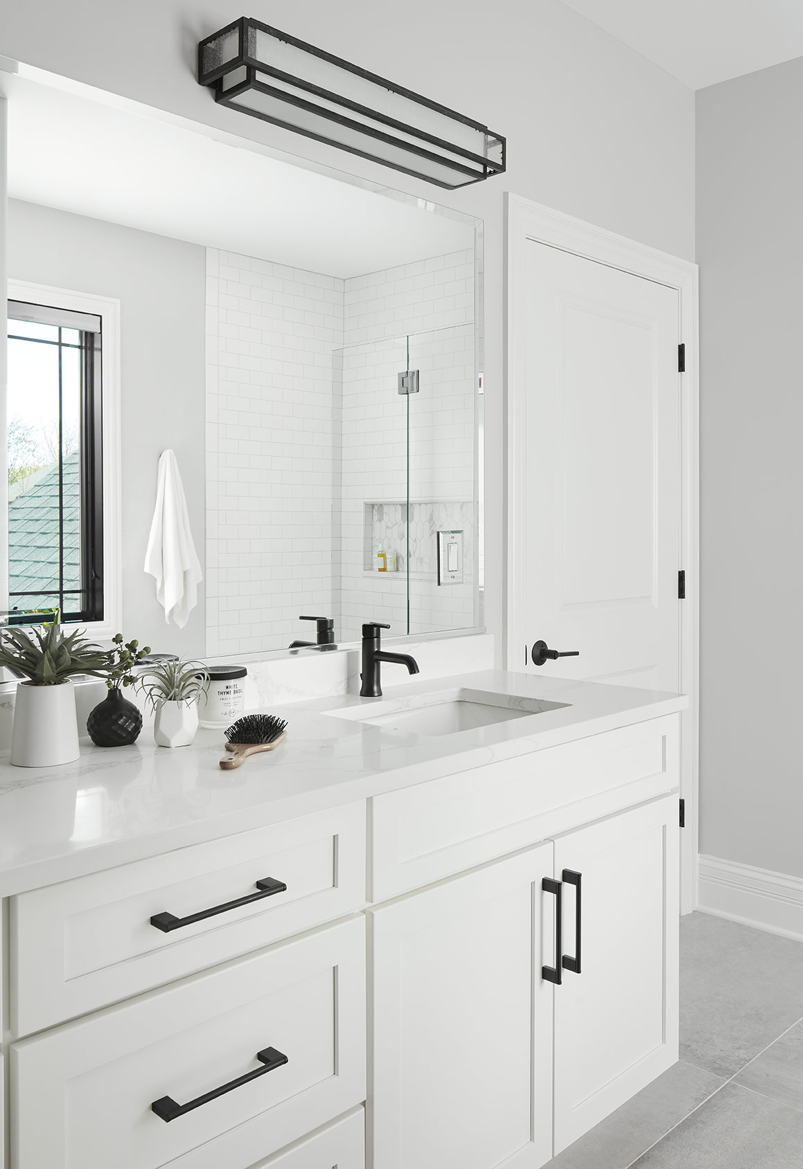 The kid's bathrooms are bright, clean spaces for them to enjoy with subtle textures introduced in the tiles and countertop.
