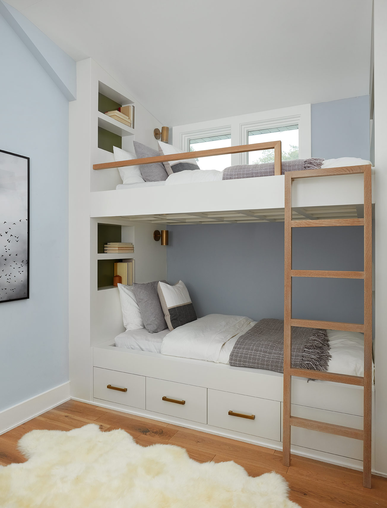 Last but CERTAINLY not least, at the top of the stairs, we built-in custom bunk beds to maximize the efficiency of the space and add a playful, fun vibe to the house!