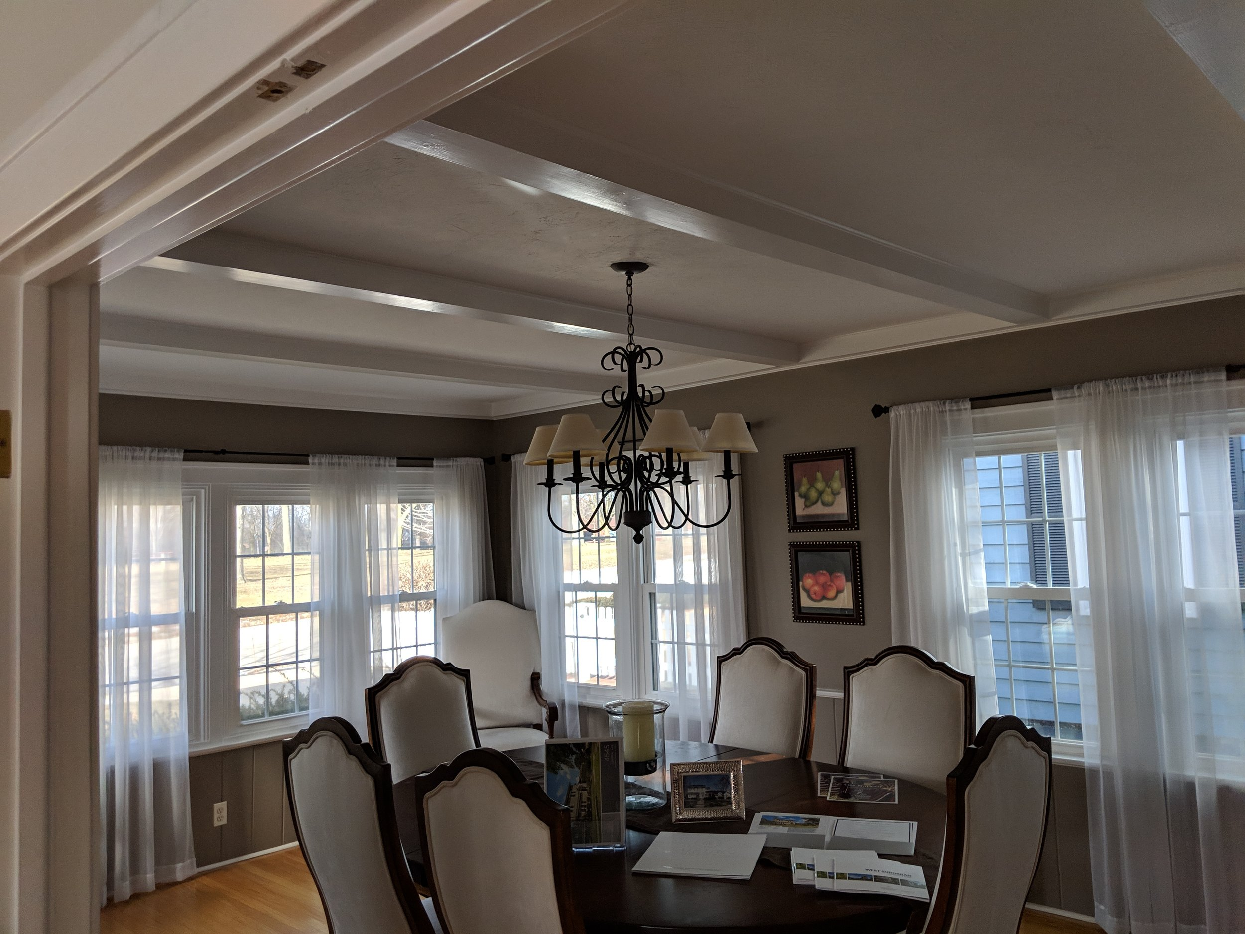 The existing dining room was surrounded with windows, and had a unique ceiling with beautiful beams running across it to add some height and texture to the space but it needed to be brightened up, and it deserved a longer table to really take advantage of the space.