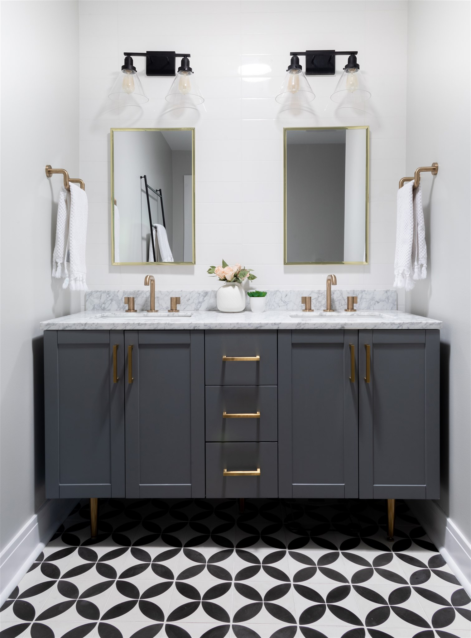 Behind the vanity and in the shower, we installed long subway tiles to give a modern yet familiar feel and add a soft touch to balance out the bold floor tiles.