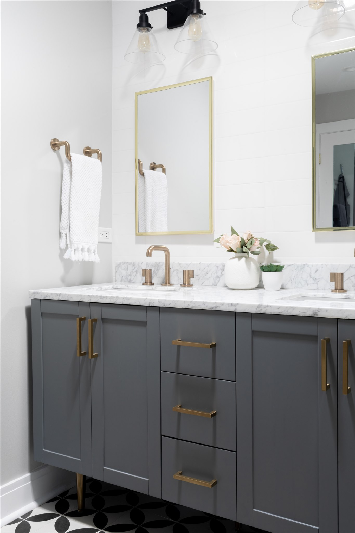 Above the vanity, there's a skylight that floods the space with natural light. The perfect spot for doing makeup!
