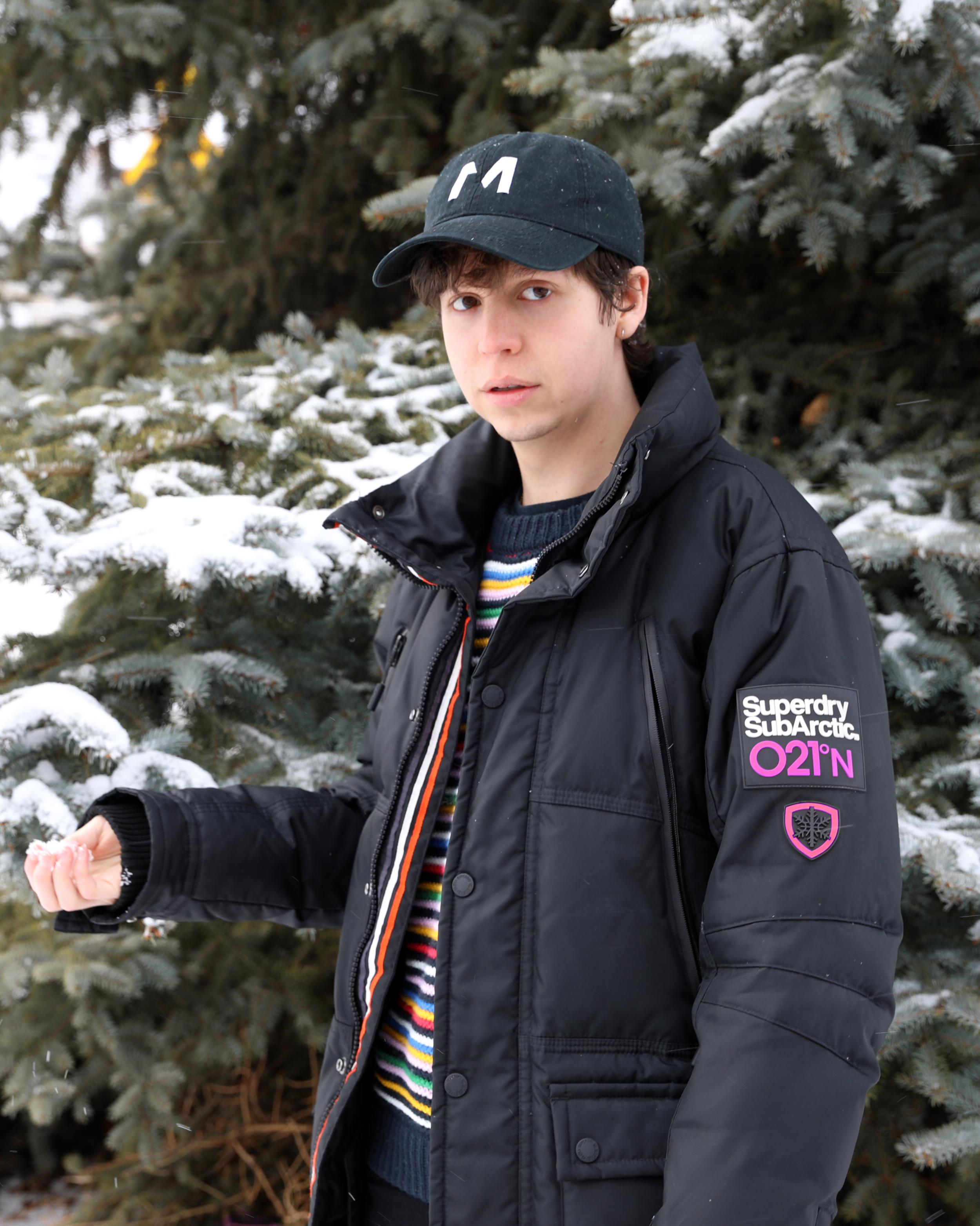 utah me in front of tree pink jacket.png