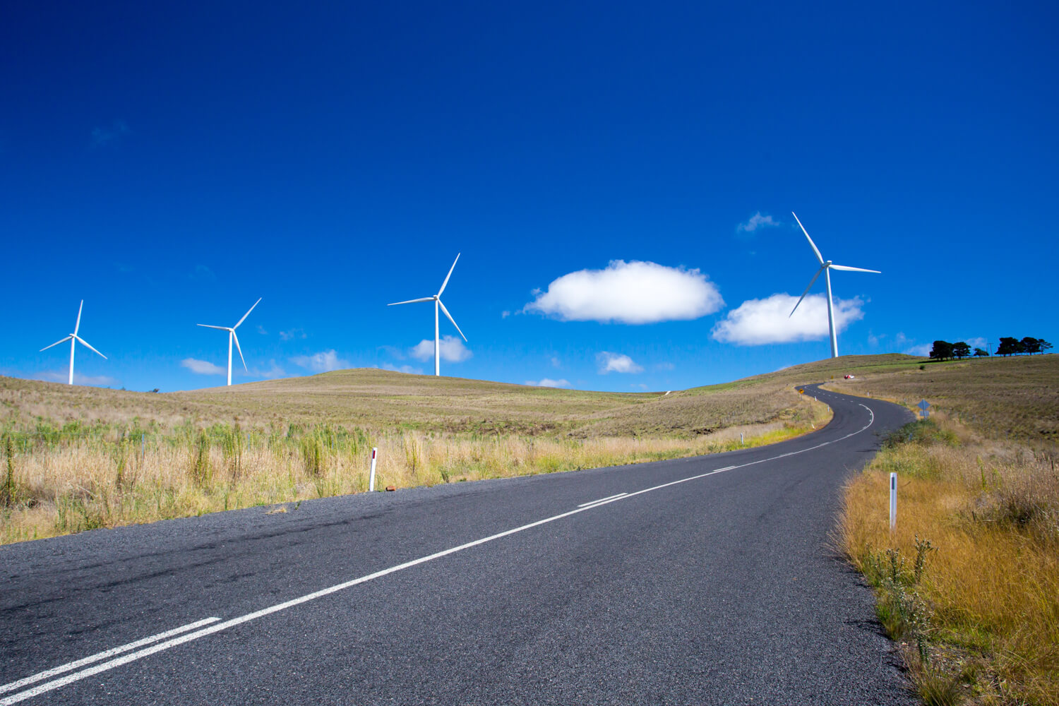 Road with wind turbines. Environmental impact assessments and approvals.