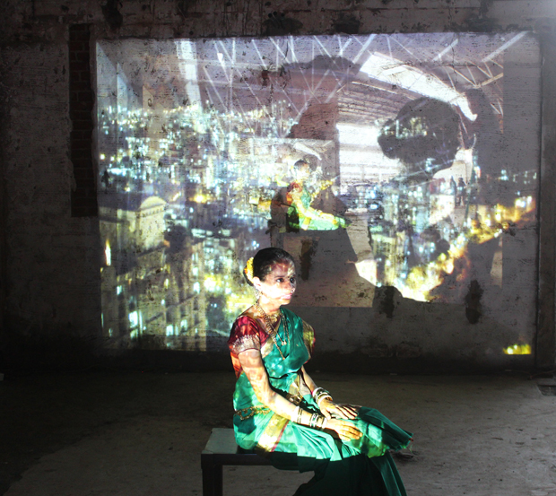 A girl in a saree poses in the installation. Photograph by Anil Kulkarni.