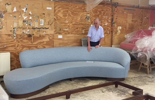 Hugh showing an amoeba sofa that we have just made for a client.