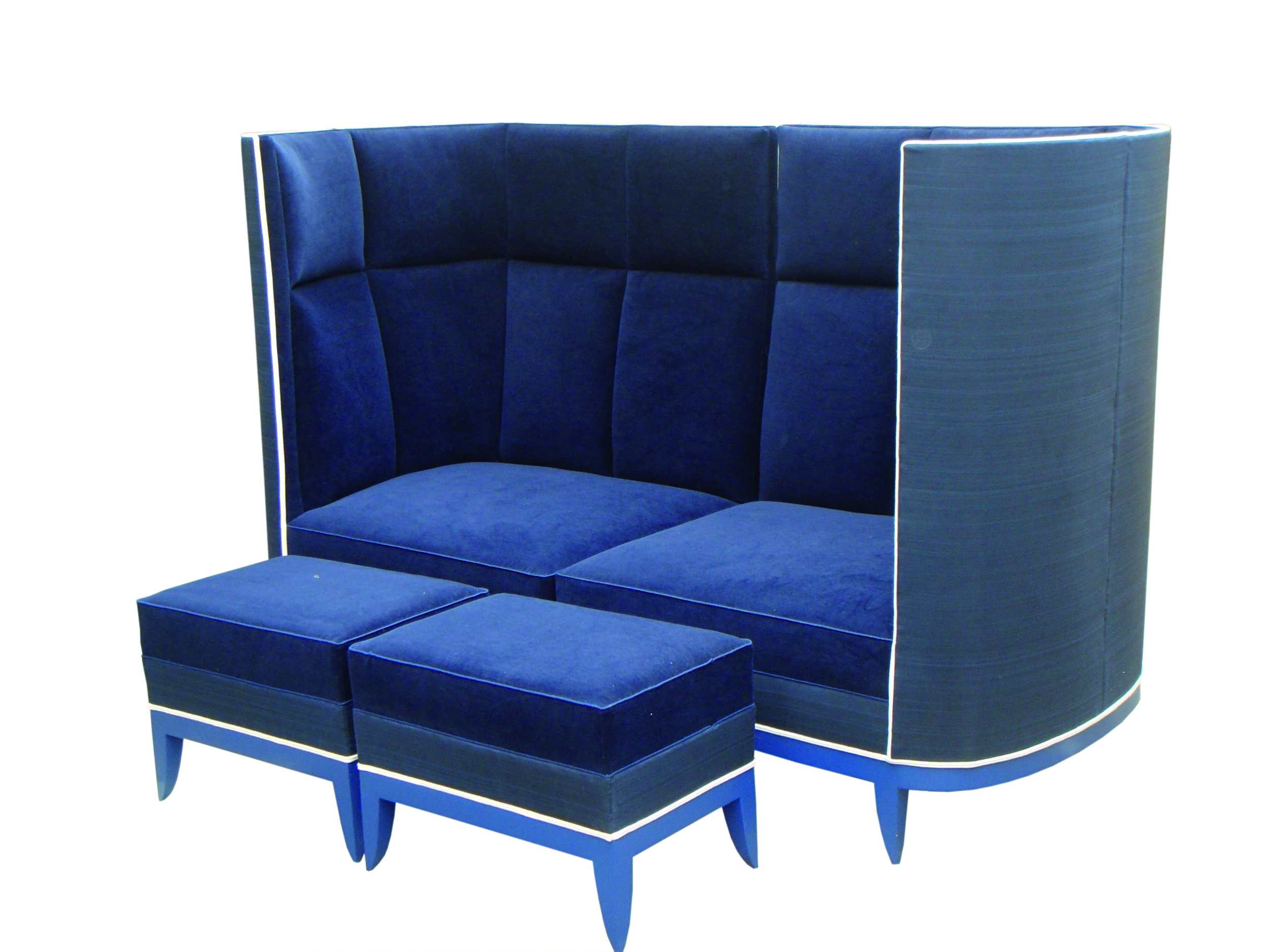 This high backed sofa with run up stools was a particularly striking piece, which we made four of for the Dorchester. We used gloss painted showwood in blue and white to complement the plush blue upholstery.