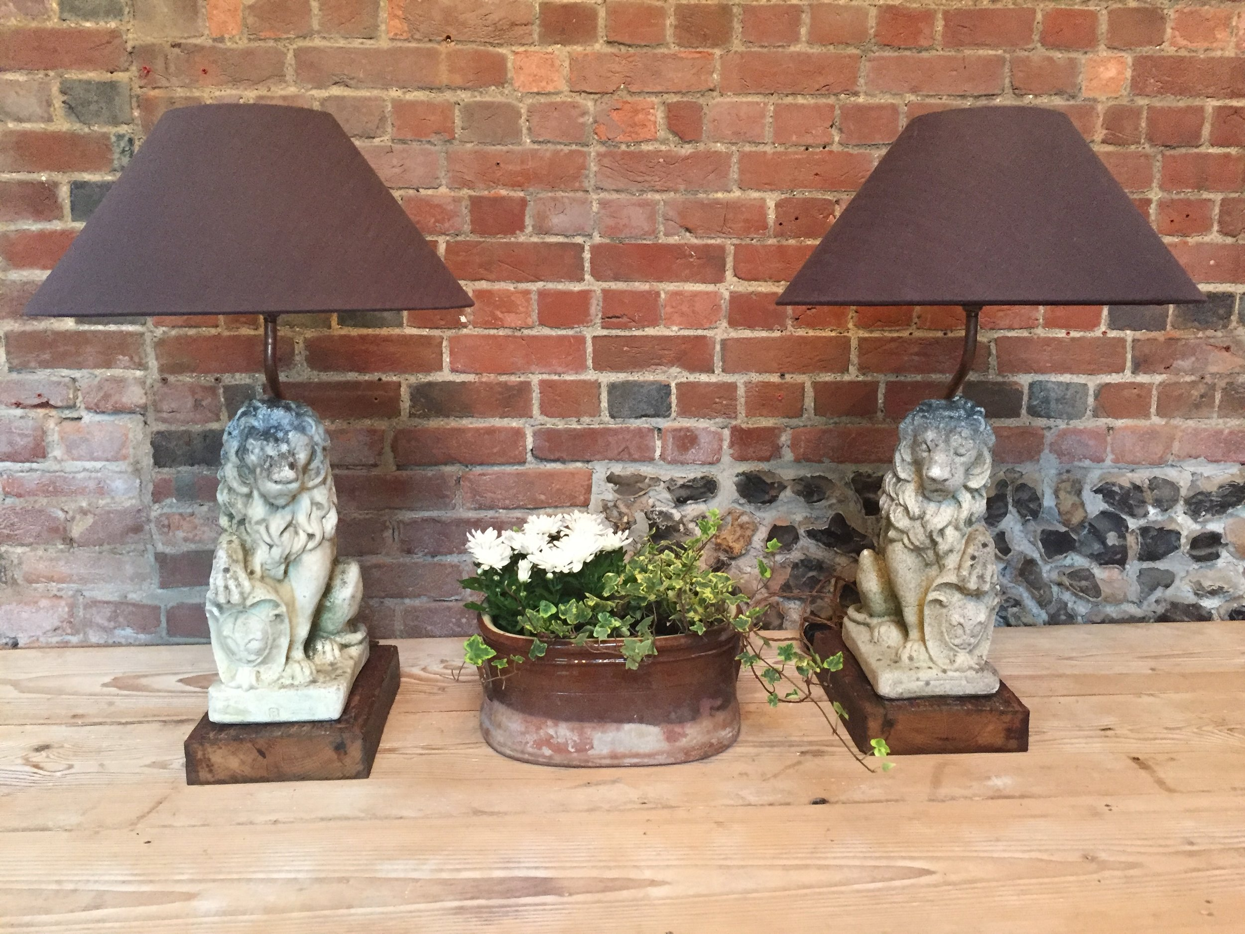 A pair of leonine table lamps. Unique! 85cm high.  SOLD