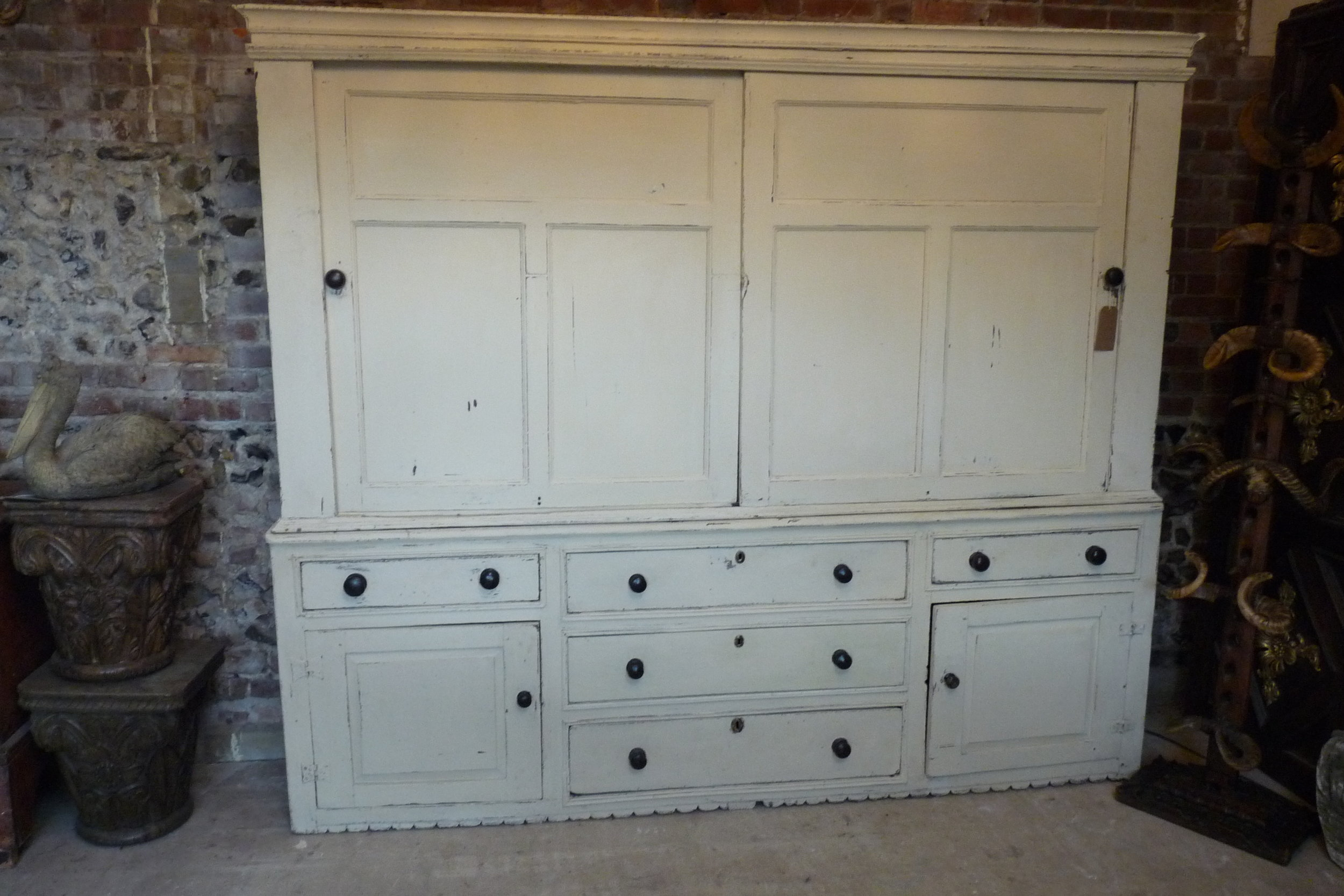 Large Georgian painted housekeeper's cupboard with sliding doors and unusual decorative plinth from a farm house in Derbyshire. £3,750