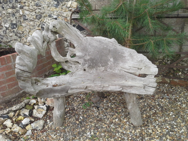 2 seater rustic garden bench made from a tree root. £495