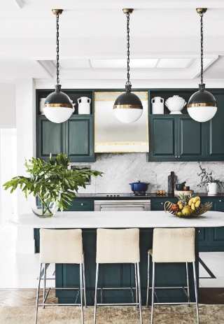 A South African home showcases mixing bold color tones with white from the netry, to the kitchen and bathroom. Beautiful greys, green, sblues and blacks that never overwhelm the space.