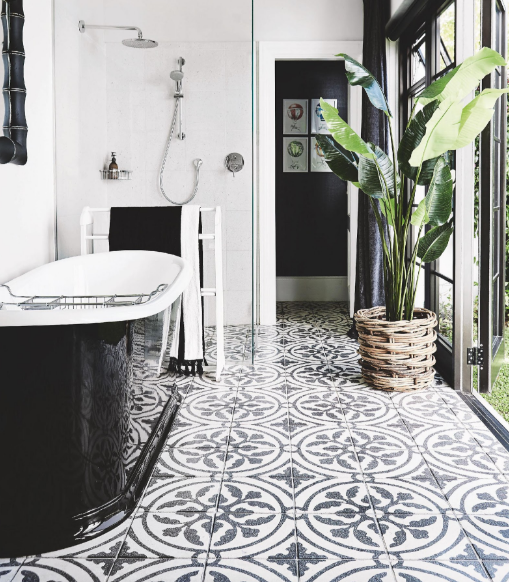 A South African home showcases mixing bold color tones with white from the entry, to the kitchen and bathroom. Beautiful greys, greens, blues and blacks that never overwhelm the space.