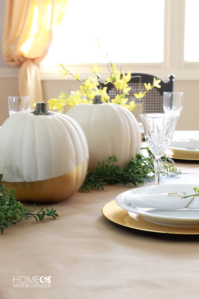 Beautiful gold-dipped pumpkins set the stage on this fall table.