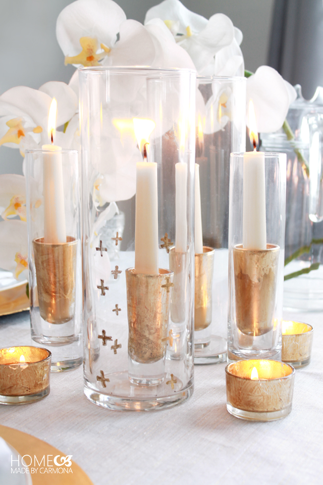 Simple arrangement of candles in keeping with the gold and white theme of this fall table.