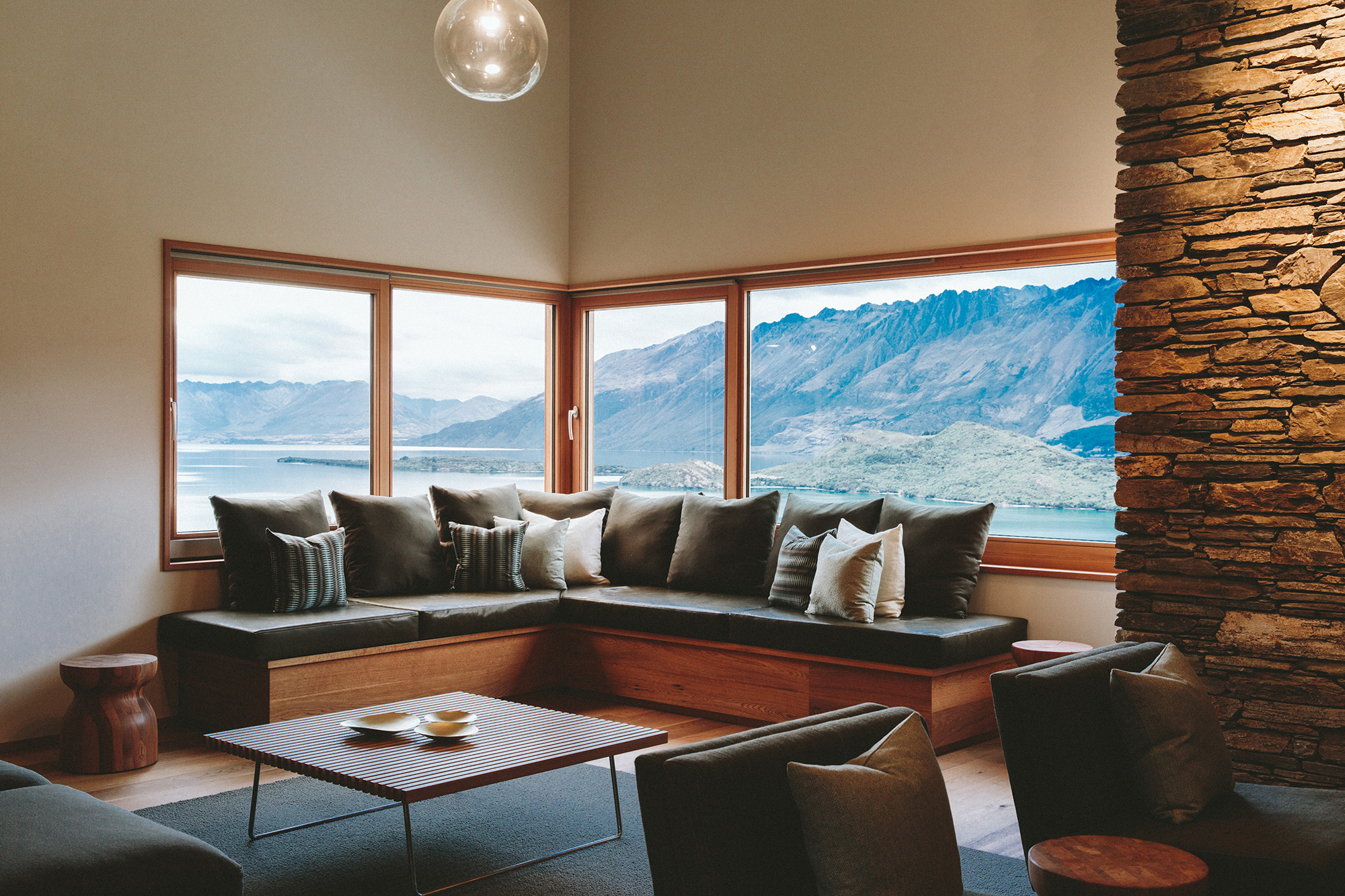 Living room setting with windows looking out at a mountain view