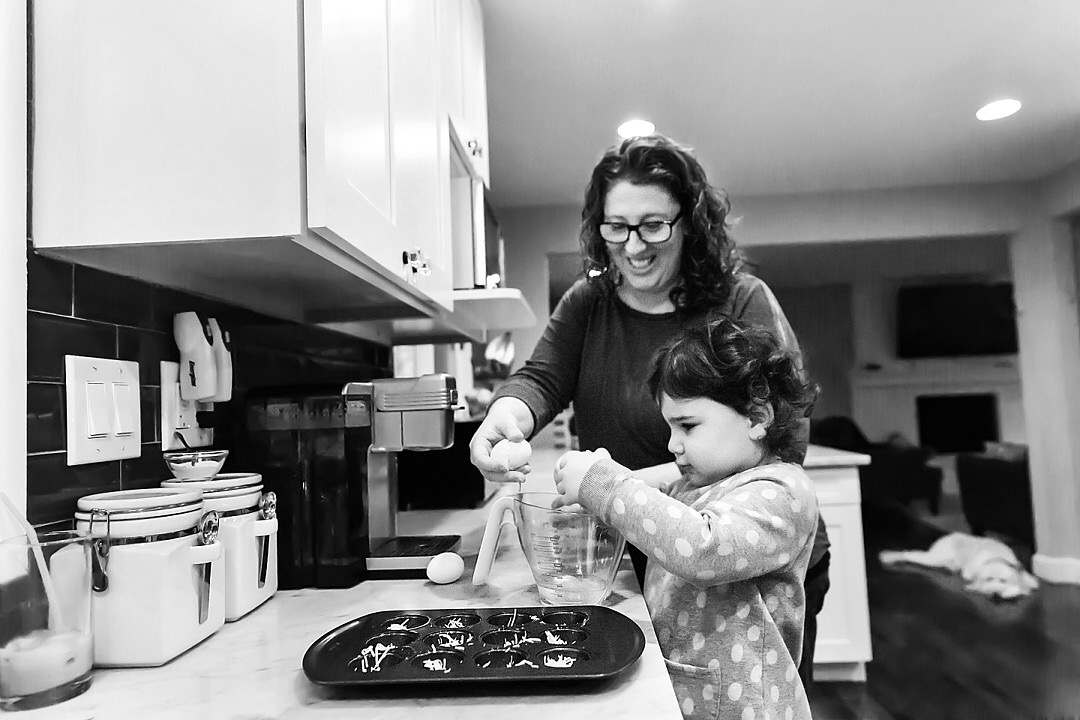 Julie & her Daughter cooking at home.
