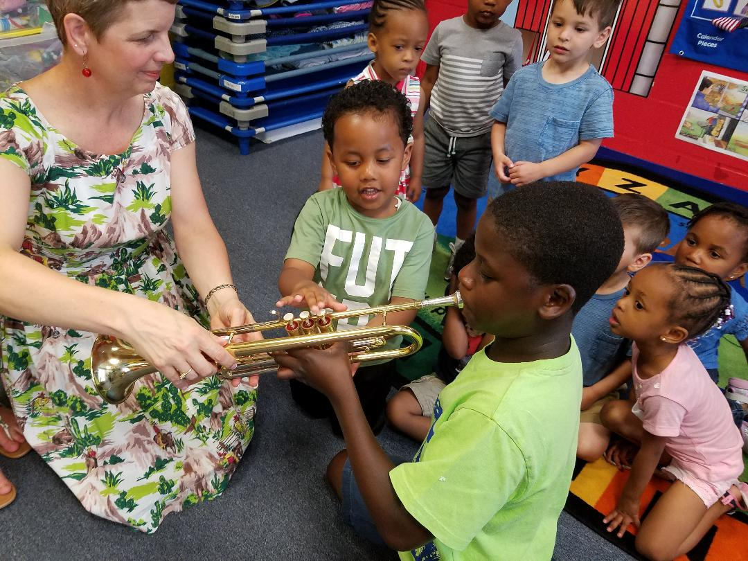 Ms. Georgia is teaching us about the trumpet!