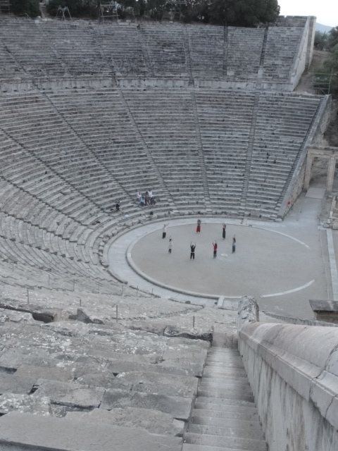 Phillip Zarrilli leads preliminary breathing exercises in the ancient theatre at Epidavros, 2011.