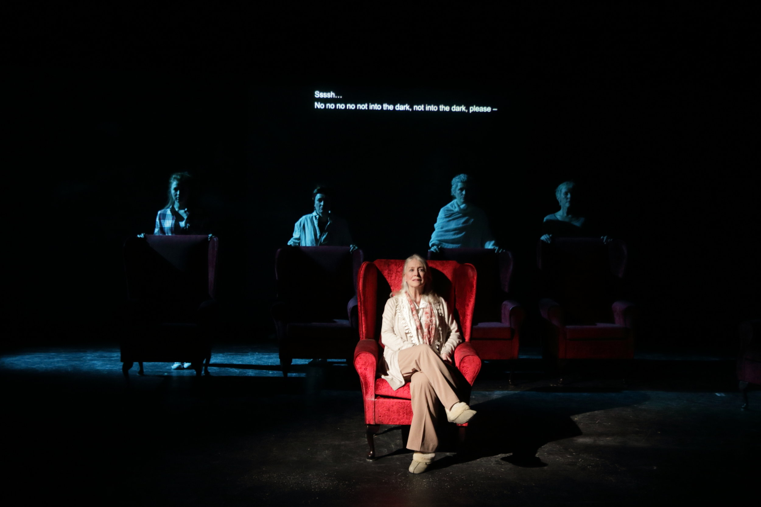 The final scene in  Cosy.  Rose (seated) with her granddaughter, and three daughters behind her.