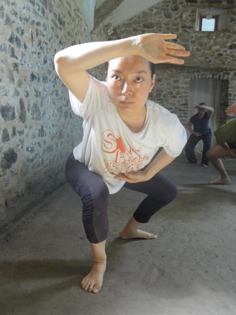 Jeungsook Yoo practicing  kalari tanjam  steps/forms at the Tyn y parc studio/kalari, West Wales..