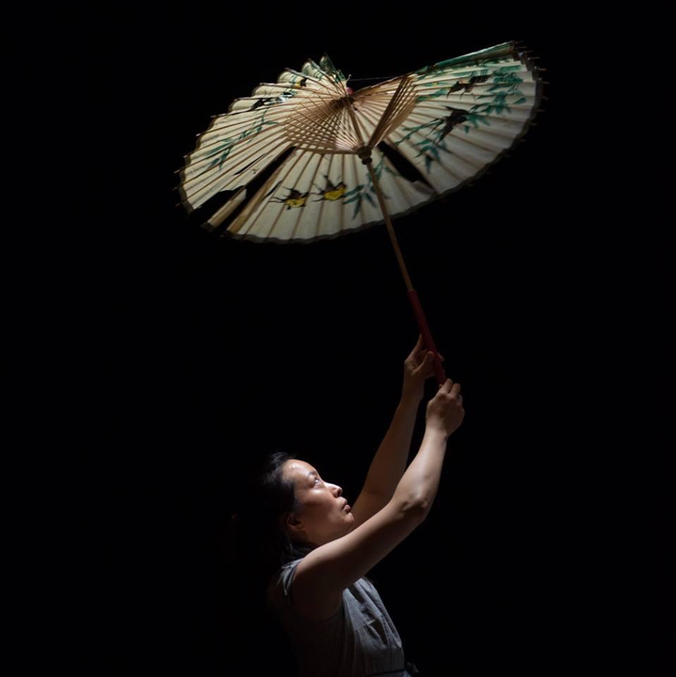 Jeungsook Yoo as Woman with Parasol, Scene 3.