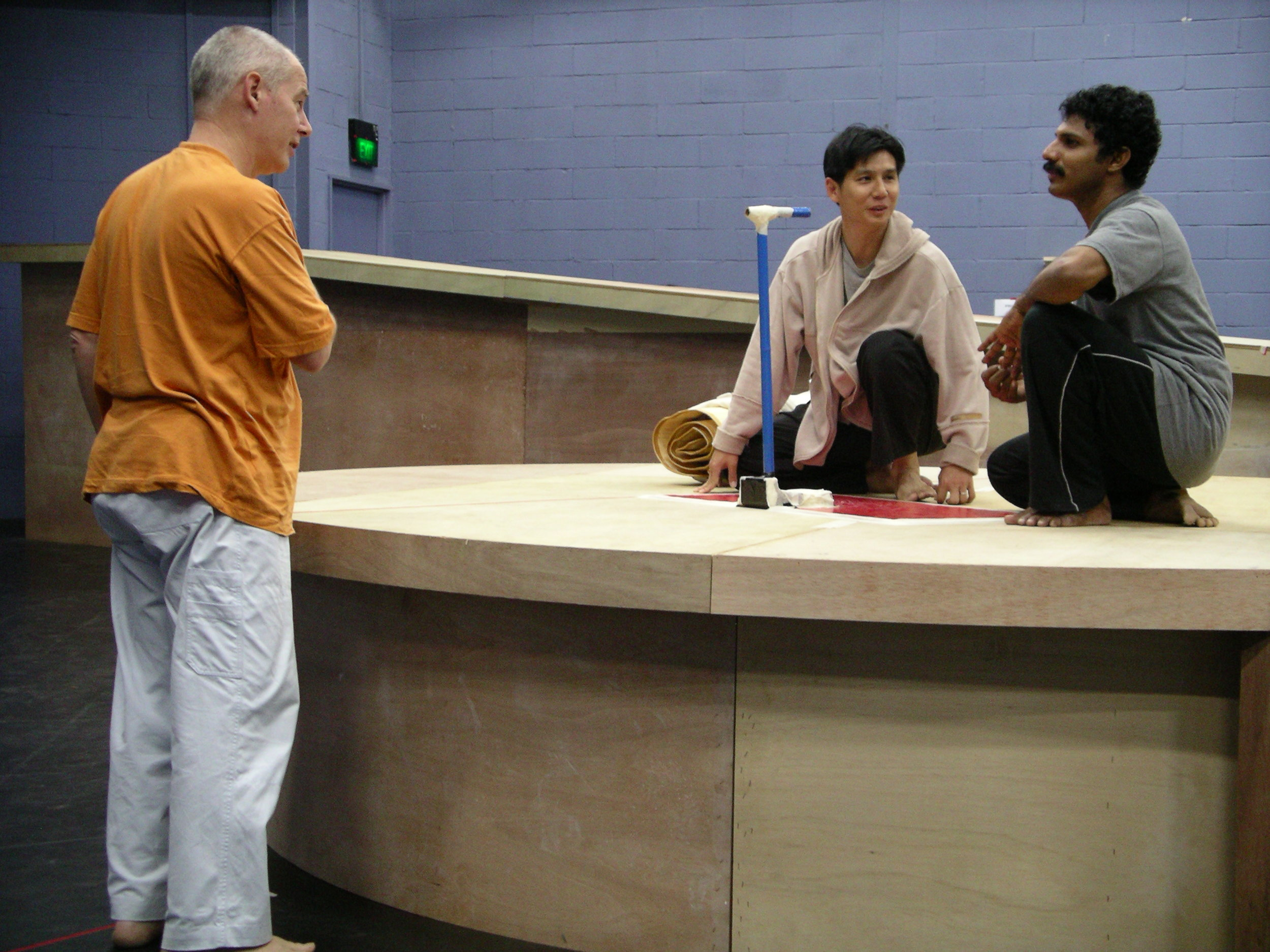 Phillip Zarrilli in rehearsals of Scene 2 with Pern Yau and Naushad (Man 1 and Man 2) for the 2004 TTRP production of Ota Shogo's  The Water Station.