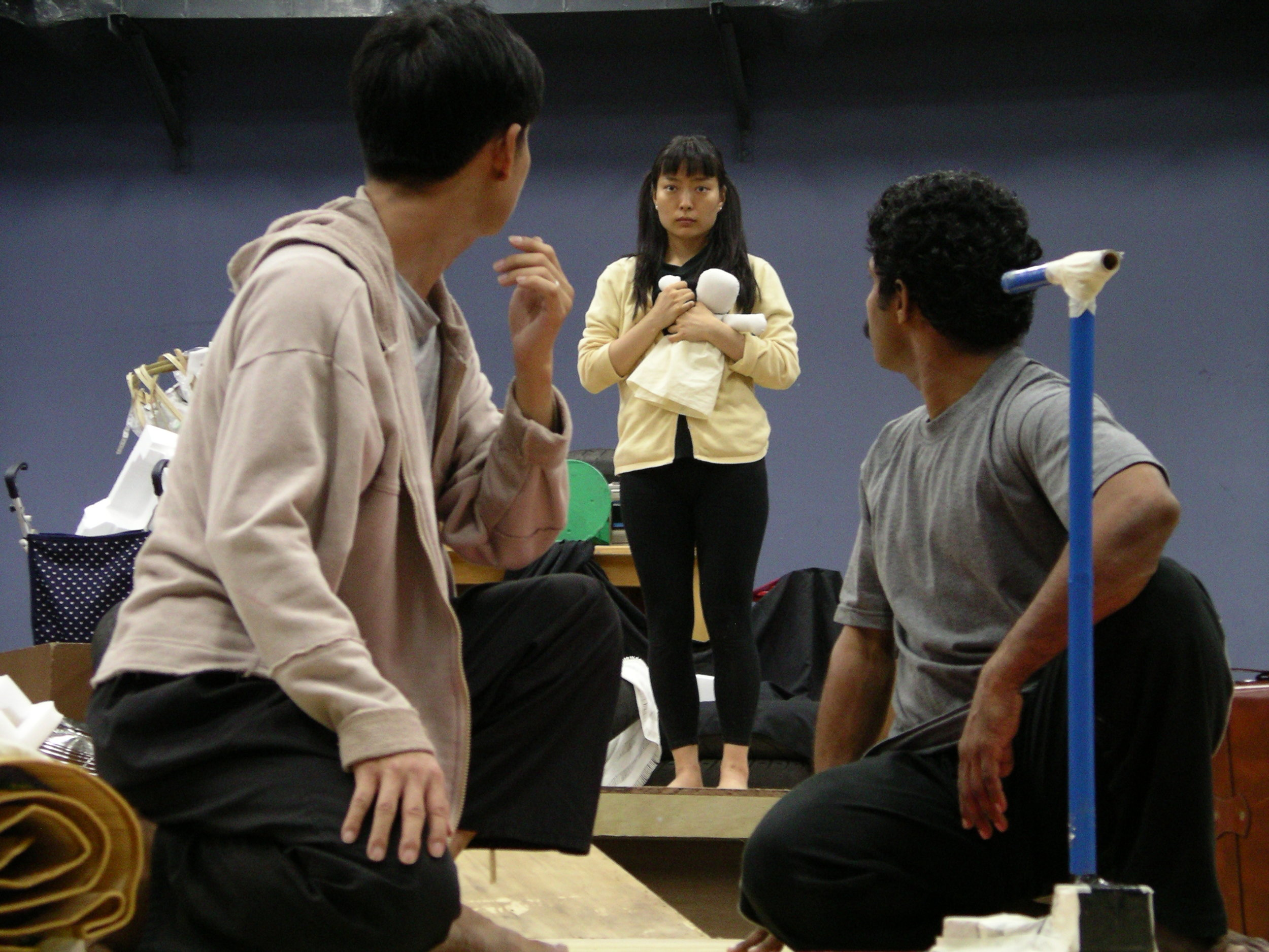 The encounter between Man 1 and Man 2 and The Girl (Jeungsook Yoo), during TTRP rehearsals of  The Water Station  in 2004.
