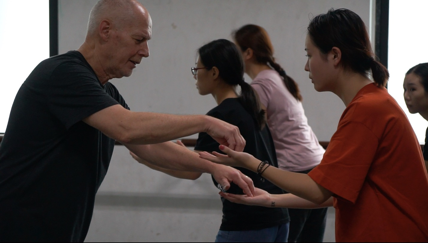 At work with Jinwen on principles of the training including emphasising sensory awareness of the palms while carrying a 'heavy load'--preliminary work on this specific structured improvisation.