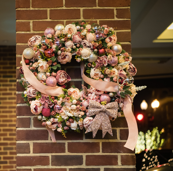 A pastel palette is not what typically comes to mind with seasonal decor, but this wreath would have you doing a double take. Pale pinks make for an enchanting and sophisticated backdrop. -